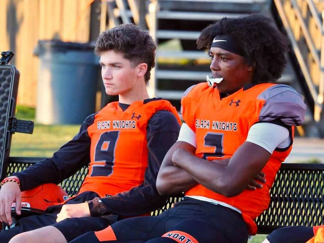 North Davidson High School student and athlete Gavin Hill (left) sits beside quarterback Tedric Jenkins during the state playoff game against Salisbury. Hill, a multi-sport athlete at the high school, had his football season put on hold after he was diagnosed earlier this year with cancer for a second time. The community is holding a fundraiser for him to help with the expenses of his treatment on May 15 at Center United Methodist Church.