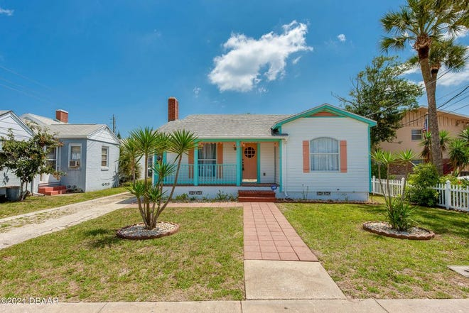 This 1941 seaside retreat, just a block from the beach, features a two-bedroom, one-bath main house, a one-bedroom, one-bath in-law suite and a basement.