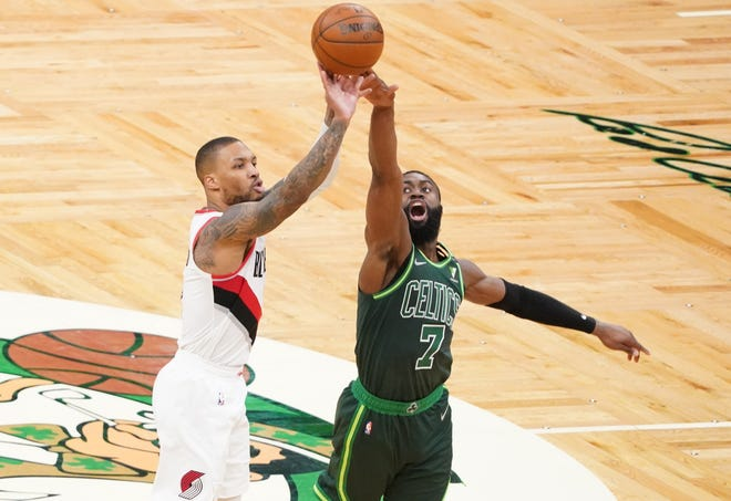 May 2, 2021; Boston, Massachusetts, USA; Portland Trail Blazers guard Damian Lillard (0) shoots against Boston Celtics guard Jaylen Brown (7) in the second quarter at TD Garden.