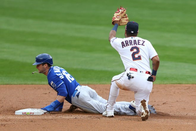 Minnesota Twins second baseman Luis Arraez, right, tags Kansas City Royals runner Andrew Benintendi, left, out at second base after as he tries to steal second in Sunday's game. The Royals lost 13-4 but finished the nine-game road trip with a 6-3 record.