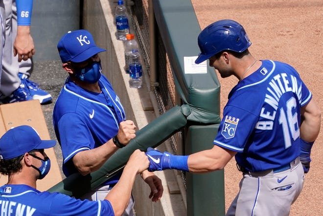 Kansas City Royals' Andrew Benintendi, right, gets a fist bump from manager Mike Matheny, left, after Benintendi's solo home run in the sixth inning Saturday's game in Minneapolis. Benintendi hit two home runs to help the Royals to an 11-3 win.