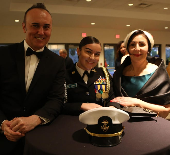 Amra Blekic (right) and her husband and youngest daughter, Medina, had a bittersweet celebration at the Nease Junior ROTC awards banquet. After Medina graduated from Nease in 2019, the family (including another daughter) was deported to Bosnia. They now are in Germany.