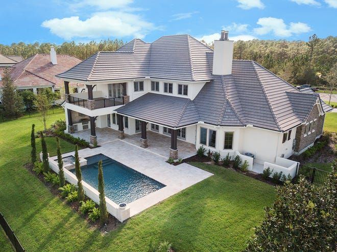 """This French country chateau in Pablo Creek Reserve, a custom design from Collins Builders, recently sold for $2,225,000. The builder's creative aesthetic and fine details helped it earn the title of """"Most Innovative Builder in Northeast Florida"""" from BUILD, an international construction and real estate publication."""