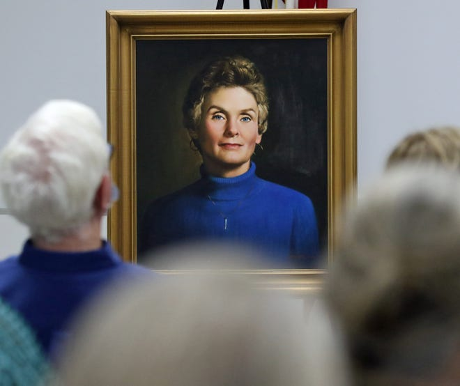 A painting of Eugenia H. Young faces the crowd during the Eugenia H. Young Memorial Library Dedication Ceremony held Monday afternoon, May 3, 2021, at the library on Howie Drive in Shelby.