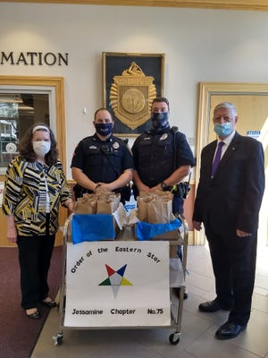 Officials from the Jessamine Chapter Order of the Eastern Star in Gardner recently presented more than 30 May Bags to the Gardner Police Department. From left are Worthy Patron Patricia Darby, Officer Kevin Goguen, Officer Ryan Spain and Worthy Patron Buddy Ducharme.