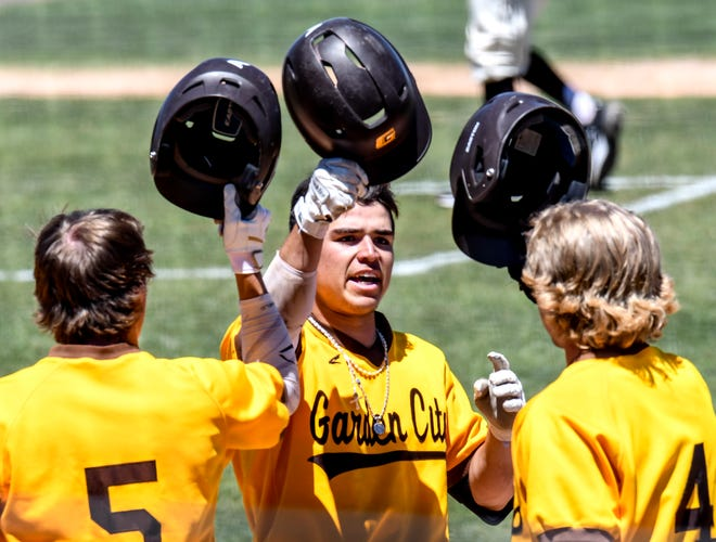 Garden City Community College's Ryan Muniz, center, taps helmets with Kyle jameson, left, and Culen Glosson after crossing the plate Saturday after smashing a home run in the second inning against Barton County at Williams Stadium.