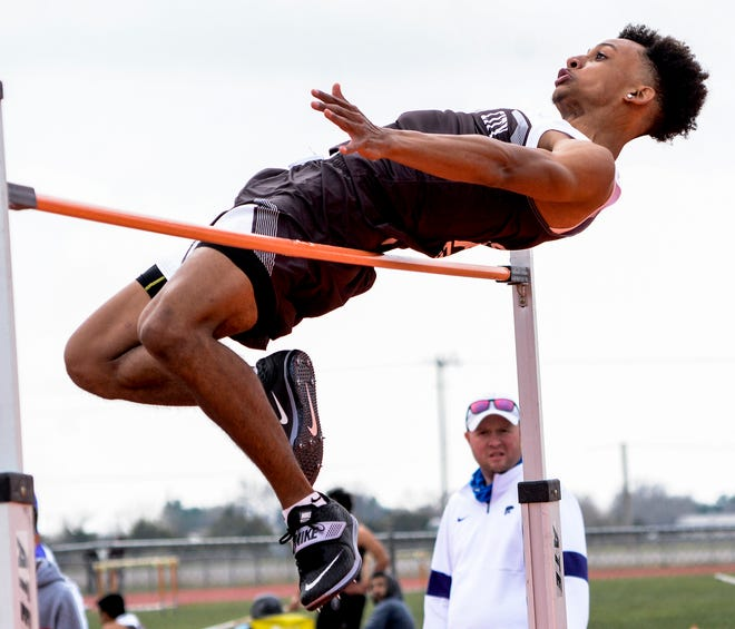 Garden City High School's Keelyn Beasley clears 6-0 in the high jump to win the Holcomb Invite event on April 23 at Holcomb.