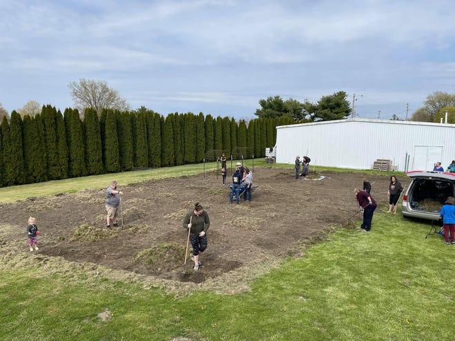 Volunteers prep ground for a community garden in Cambridge
