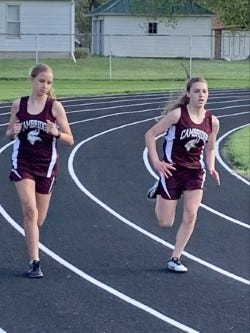 Luca Veloz and Addie Jewett race to the finish of the girls 400m run in Wethersfield