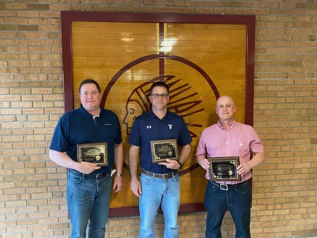 Retiring members of the Annawan School Board, from left, Teddy VanHyfte, Brian Childs and Dwaine Shaw Jr., were honored at the recent school board meeting.