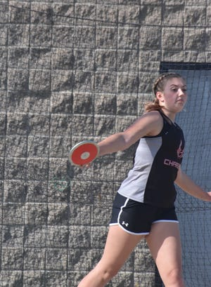 Charger Abby Bindewalk competes in the discus throw on Tuesday, April 27, in Orion.