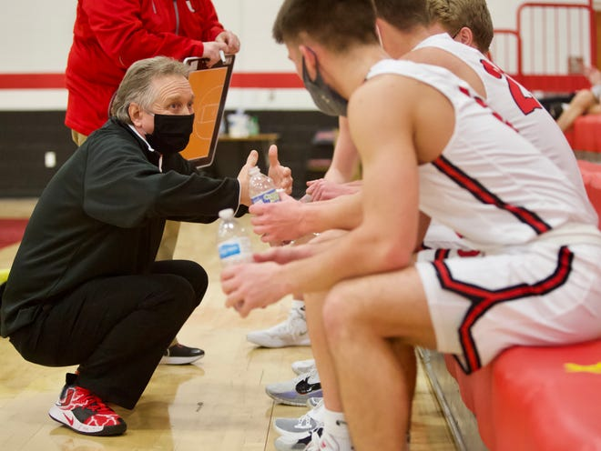 United High School boys basketball coach Doug Dennison talks to his team during a timeout in a game against Knoxville on Wednesday, Feb. 10, 2021 in rural Monmouth.