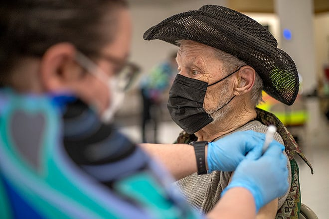 James Housh, 79, of Galesburg receives his COVID-19 vaccine injection at the Knox County Unified Command Vaccine Center walk-in clinic in the former Bergner's store on May 1.