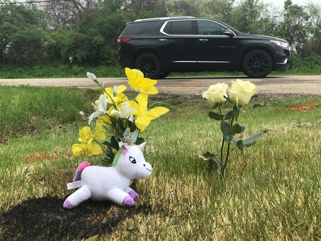 A makeshift memorial stands Monday afternoon at the intersection of West Charter Oak Road and North Charter Oak Lane in Peoria. On Sunday, a two-vehicle collision claimed the lives of two children.