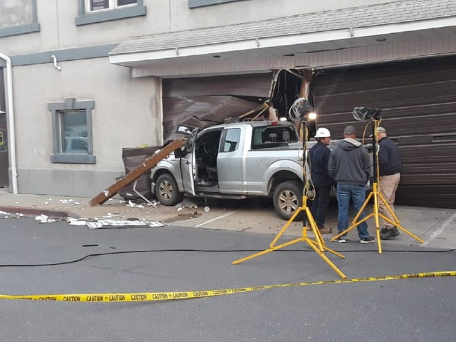 A pick up truck crashed into the bay door of Tri-Towns EMS early Saturday morning, causing Westernport's downtown to be shut down for several hours.