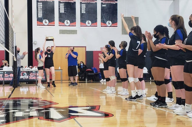 Jaiden Purcell lifts the block as Bloomfield celebrates its Section V championship win on Sunday.