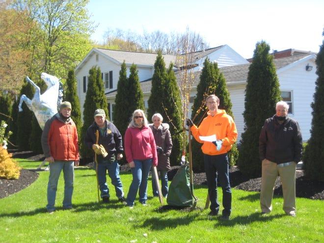Mayor Gary Hadden joins Victor Tree Board members Gene Pratt, Bob Haggett, LeiAnna Beckinghausen, Regina Muscarella and Bill Bross for the village's Arbor Day ceremony in Mead Park.