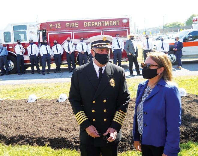 Y-12 Fire Chief Scott Vowell, left, talks to Teresa Robbins, National Nuclear Security Administration production office manager, at an event Tuesday celebrating the groundbreaking for construction of a new Y-12 Fire Station and the already-underway Y-12 Emergency Operations Center project.