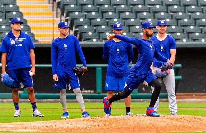 The Oklahoma City Dodgers practice Monday at Chickasaw Bricktown Ballpark ahead of Thursday's season opener.