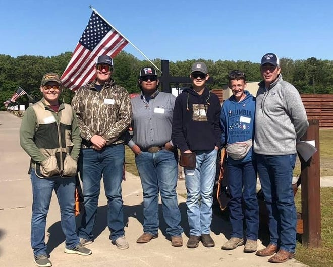 Crawford County 4-H Trap and Archery Club senior members, (from left) Zach Milsap, Judson Parker, Evan Stacy, Taylor Jones and Ross Brister with their coach Sean Brister.