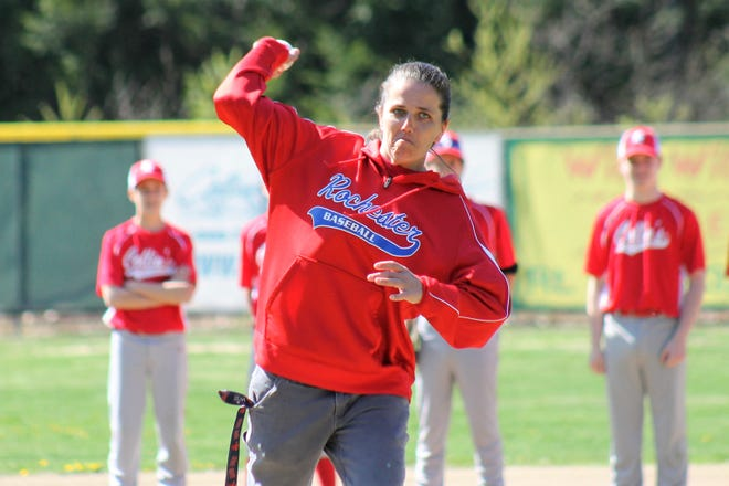 Jamie Dow is focused on the task at hand Sunday morning as she throws the ceremonial first pitch on opening day of the Rochester 13-15 Babe Ruth League at Msgr. Gilles Simard Field.