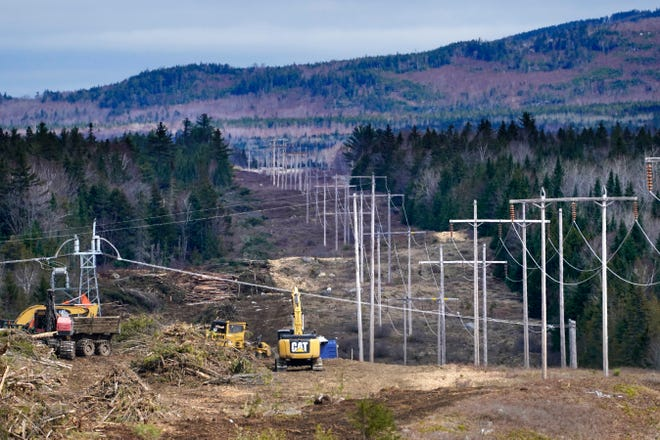 Heavy machinery is used to cut trees to widen an existing Central Maine Power power line corridor to make way for new utility poles, Monday, April 26, 2021, near Bingham, Maine. As President Joe Biden's administration plans to fight climate change by weaning the nation off fossil fuels, these large-scale renewable energy projects are the source of conflict within a seemingly unlikely group: environmentalists.