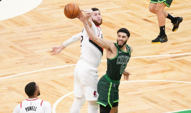 Portland Trail Blazers center Jusuf Nurkic strips the ball form Boston Celtics forward Jayson Tatum (right) in the fourth quarter at TD Garden on May 2, 2021.