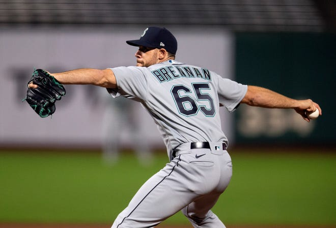 Brandon Brennan delivers a pitch against the San Francisco Giants during a September game. Boston claimed him off the waiver wire Monday from Seattle.