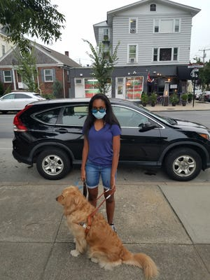 Haylee Mota, of East Providence, and her guide dog, Nicky. Mota is suing Jacky's Waterplace and Sushi Bar over the restaurant's alleged refusal to serve her due to her service dog.