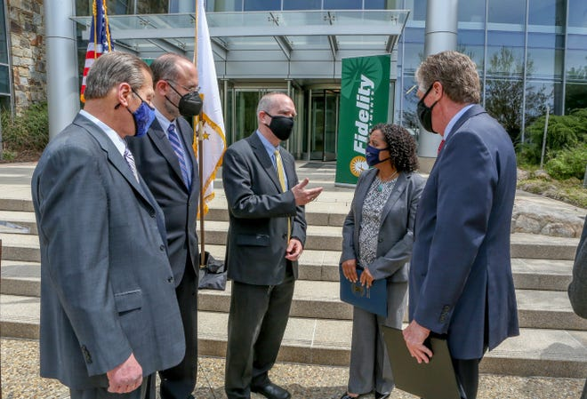 From left, Senate President Dominick Ruggerio, Commerce Secretary Stefan Pryor, Fidelity Investments' Rick Metters, Lt. Gov. Sabina Matos and Gov. Dan McKee chat after Monday's announcement at the Fidelity campus in Smithfield.