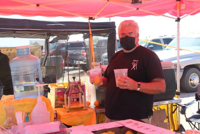 Scott Miller serves up lemonade at the Ridgecrest Farmer's Market April 24, 2021.