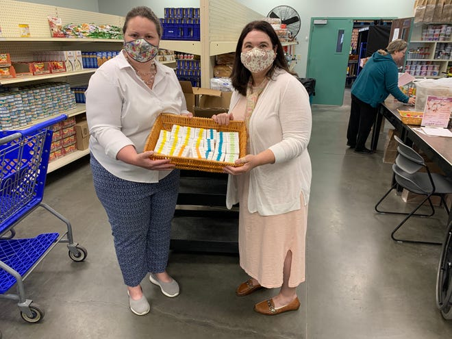 The Salina Food Bank's Karen Couch and Gratitude Soapery owner Kristin Blomquist at the food bank after Blomquist's donation.