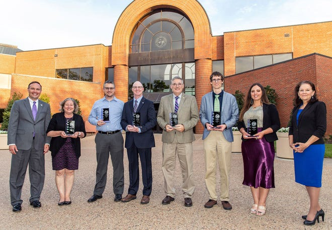 Tarleton State University presented its annual Faculty Awards on April 26, during a dinner to celebrate the 2020 and 2021 recipients. Pictured are, from left, President James Hurley with 2020 recipients Dr. Katherine Smith, Dr. Scott Cook, Dr. Jason Sharp, Dr. Rudy Tarpley, Dr. Ryan Glaman, Callie Price and Dr. Karen Murray, provost and executive vice president for Academic Affairs.