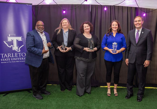 Tarleton State University presented its annual Staff Awards on April 19, during a dinner to celebrate the 2020 and 2021 recipients. Pictured are, from left, 2021 recipients Darrell Brown, Jo Ann Kern, Andrea Smith, Jenna Camp and President James Hurley.
