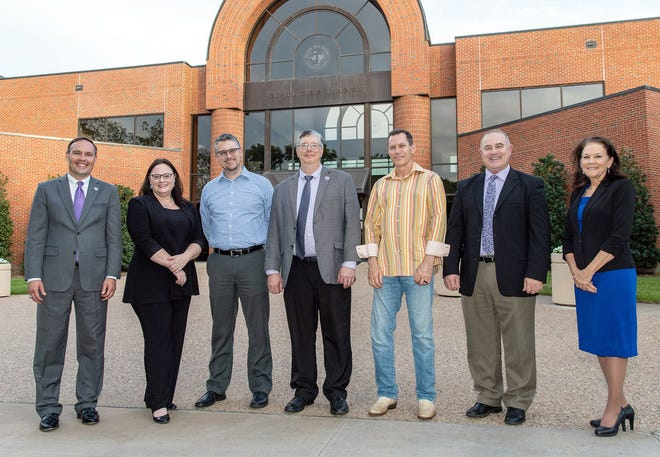 Tarleton State University presented its annual Faculty Awards on April 26, during a dinner to celebrate the 2020 and 2021 recipients. Pictured are, from left, President James Hurley with 2020 recipients Dr. Tara Shelley, Dr. Scott Cook, Dr. Keith Emmert, Dr. Bryant Wyatt, Dr. David Frazier and Dr. Karen Murray, provost and executive vice president for Academic Affairs.