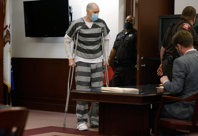 Adam Lopez enters the courtroom of Associate Judge Rudolph Braud at the Sangamon County Complex in Springfield, Ill., Monday, May 3, 2021.