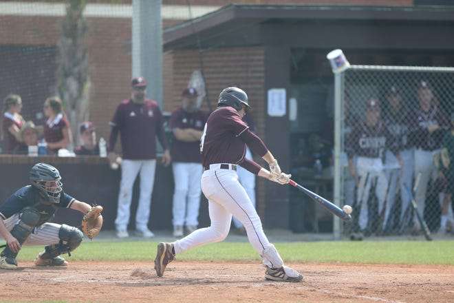 Benedictine's Carter Holton hits his second home run of the game during Monday's state playoff game against Thomas County Central.