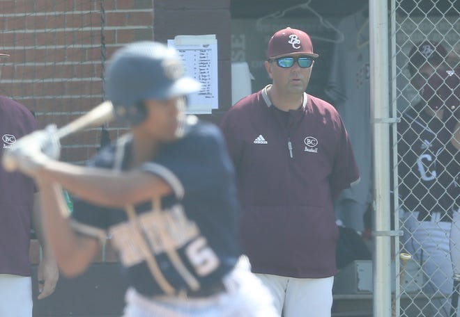 Benedictine head coach Kevin Farmer watches from the dugout during a recent playoff game against Thomas County Central.