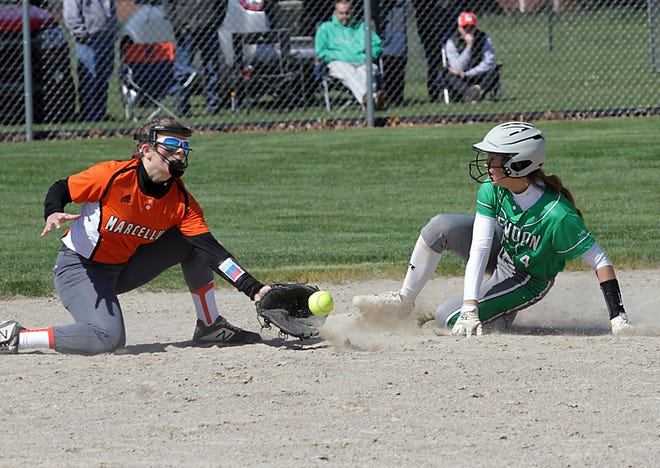 Payton Griffith of Mendon slides safely into second base before Marcellus shortstop Clare Flory can apply a tag on Saturday morning.