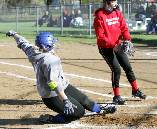 Hanna Poley of Burr Oak slides safely into home plate to score a run on Saturday morning against Tekonsha.