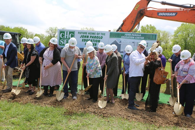 Members of the John Parolo family, CHC/SEK executives and other donors breaking ground on the John Parolo Education Center Monday afternoon.