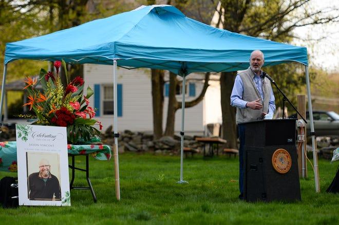 Planimetrics president Glenn Chalder, of Avon, delivers remarks during the memorial celebration of life to honor Jason Vincent, president of the Norwich Community Development Corp., Sunday, May 2, 2021, at the Bozrah Farmers Market.