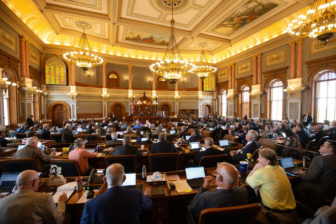 The Kansas House took several votes to override Gov. Laura Kelly's vetoes on a slate of legislation Monday at the Statehouse.