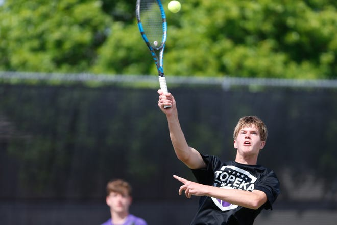 Topeka West's Miles Cusick, front, returns a volley with his doubles partner Ian Cusick, back, during Monday's Centennial League tournament at Kossover Tennis Complex.