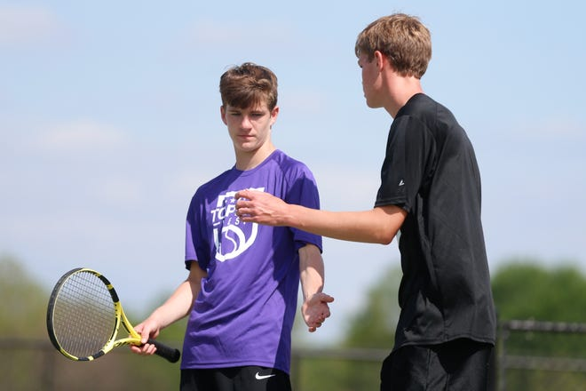 Topeka West's doubles team of Ian Cusick, left, and Miles Cusick, right, celebrate a point in their match during Monday's Centennial League tournament at Kossover Tennis Complex. The Cusicks captured the league title in doubles with an 8-6 win over Emporia, helping the Chargers finish second as a team.