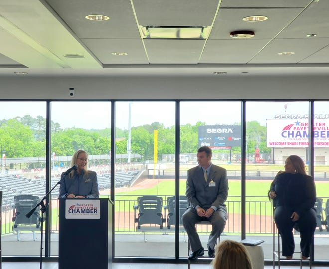 New Greater Fayetteville Chamber of Commerce President and CEO Sheri Fiveash, left, speaks during a press conference announcing her appointment Monday at Segra Stadium in Fayetteville. She's joined by Chairman of the Board Brian Pierce, center and Vice-Chairperson Tammy Thurman.
