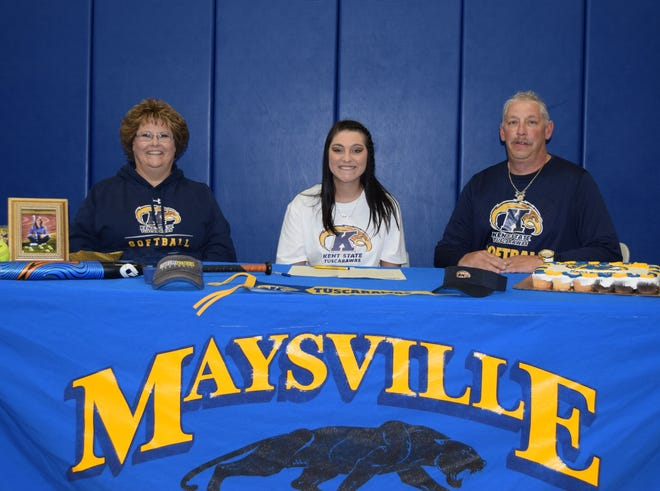 Signing a letter of Intent is Kaitlyn Hobson seated between her mother Mysti and her father Doug.