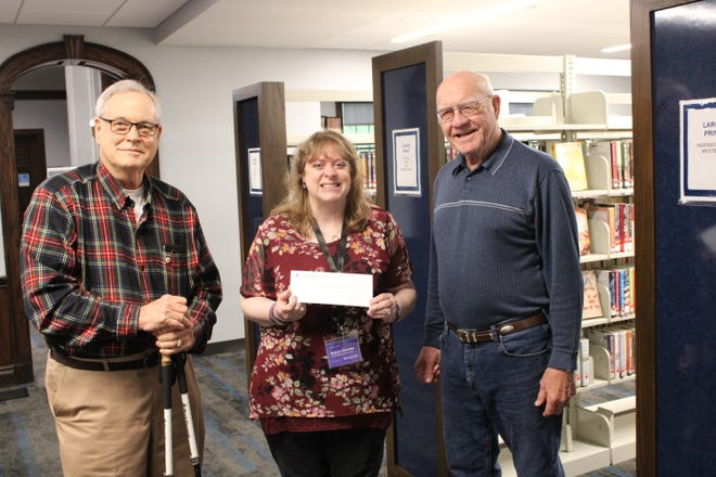 President Bill McEwan and club member Ward Holdsworth present TCPL adult and teen services manager Robyn Guedel with the donation. Pictured, from left: Bill McEwan, Robyn Guedel and Ward Holdsworth.