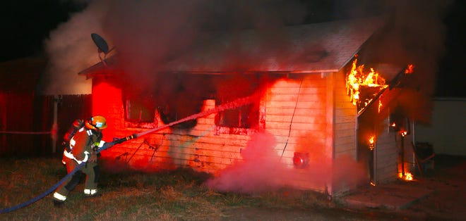 Firefighters knock down fire that damaged a residence after occupant was assaulted