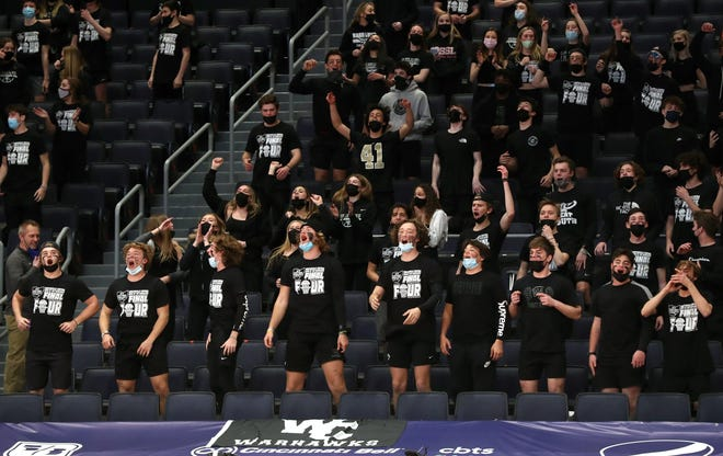 The Westerville Central student section cheers on the Warhawks boys basketball team at the start of a Division I state semifinal against Cleveland St. Ignatius on March 20 at University of Dayton Arena.